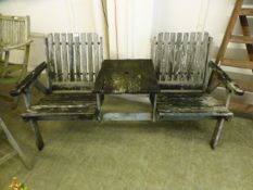 A weathered teak two seat garden bench w