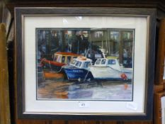 A framed and glazed watercolour of boats