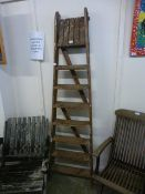 A set of wooden step ladders