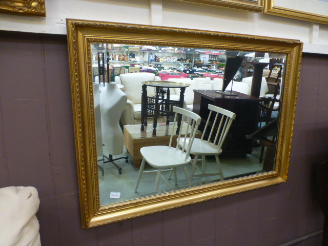 Lot 69 - A modern gilt framed beveled glass mirro