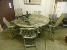 A weathered teak garden table along with