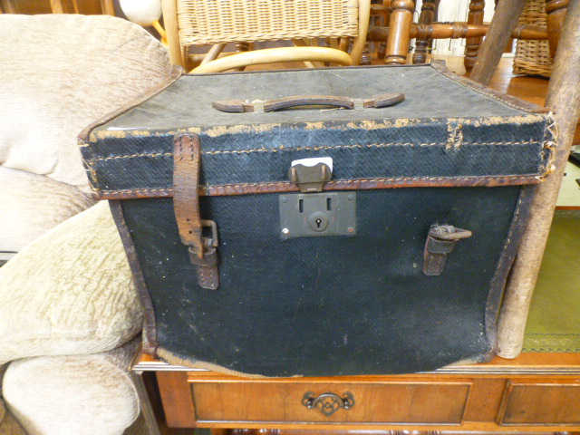Lot 136 - A leather and canvass travelling case