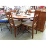 A modern oval dinning table with a set o