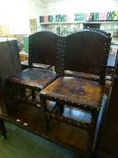 A set of four early 20th century oak and