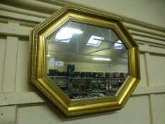 An ornate gilt framed octagonal mirror