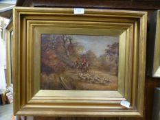 A gilt framed oil on board of hunt scene