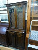 An early 20th century oak bookcase, the