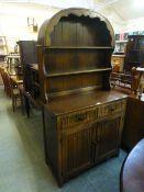 A reproduction oak dresser, the arched t
