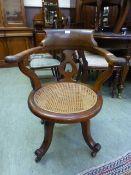 A 19th century mahogany swivel office ch