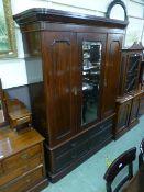 A late 19th century mahogany wardrobe, t