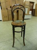 A 19th century bentwood correction chair