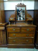 An Edwardian walnut dressing chest, the