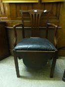 An 18th century mahogany commode chair