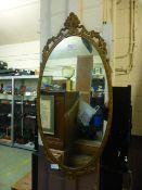 A gilt metal framed oval mirror