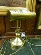 A reproduction brass adjustable desk lam