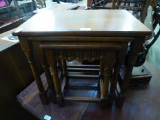 A nest of three reproduction oak tables
