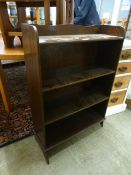 An early 20th century ply open bookcase