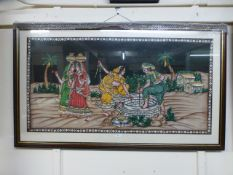 A framed and glazed Indian print on cott