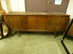 A mid-20th century teak sideboard having