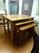 A nest of three teak veneered occasional