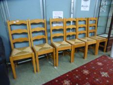 A set of six ladder back kitchen chairs