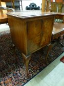 A reproduction burr walnut pot cupboard