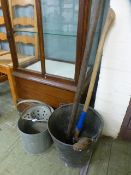 An iron stake, axe and two buckets along