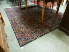 A modern blue ground rug with foliate de