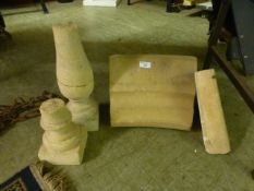 Four carved, moulded and turned stonewar