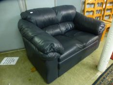 A charcoal grey leather two seat sofa