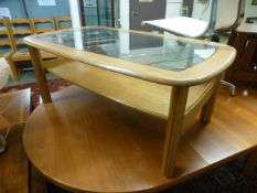 A modern ash coffee table with glass top