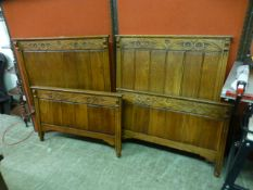 A pair of early 20th century oak single