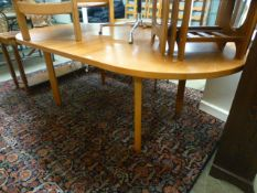 A teak extending dining table