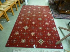 A modern red ground rug