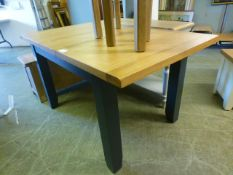 An oak topped extending dinning table with dark grey base (26.