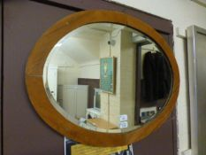 A pine framed oval bevelled glass mirror