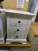 A white three drawer bedside chest (6.