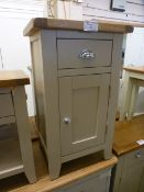 An oak topped grey based bedside cabinet (8.