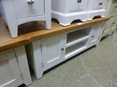 An oak topped white based media cabinet (41.