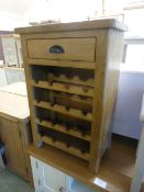 An oak wine rack with single drawer (29.