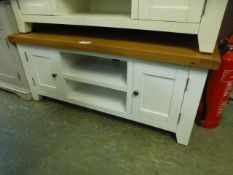 An oak topped white based low level media cabinet (38.