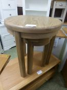 Two circular oak occasional tables (20.