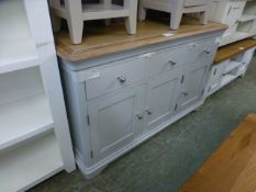 A limed oak topped grey based sideboard, three drawers over three cupboard doors (28.