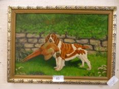 A framed oil on board of a dog with pheasant in mouth signed L.