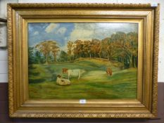 A gilt framed oil on board of cows in field signed W.