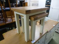 A nest of two oak topped occasional tables (13.
