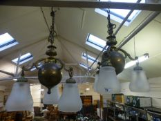 A pair of brass three branch chandeliers