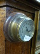 A reproduction ships barometer on wooden mount