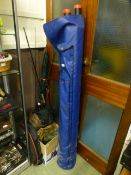 A large selection of fishing equipment to include rods, umbrellas, bags etc.