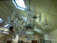 An early 20th century cut glass five branch chandelier